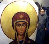 Fr. Luke with wall size head of Theotokos